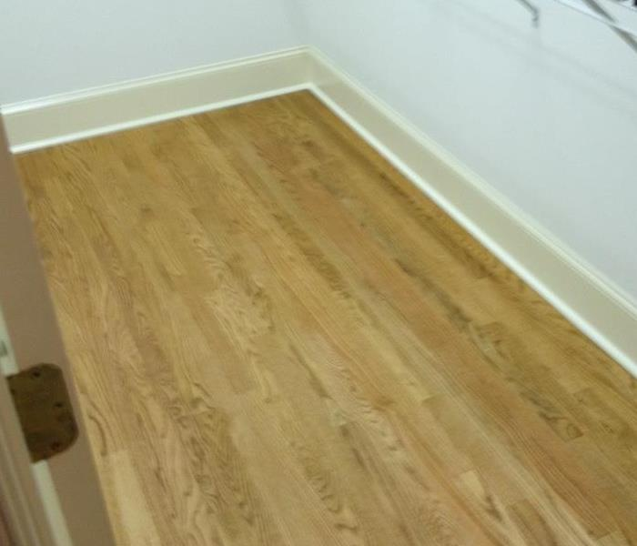 Water Heater Leak Results in Buckling Hardwoods After