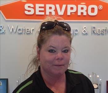 Female employee standing in front of SERVPRO sign