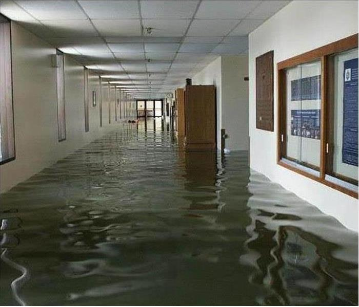 Flooded hallway in office building